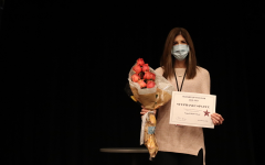 Coppell High School IB English teacher Stephanie Spaete is awarded roses and a certificate in the CHS Auditorium during first period Wednesday. Spaete was named CHS's 2020-21 Teacher of the Year. Photo by Lilly Gorman