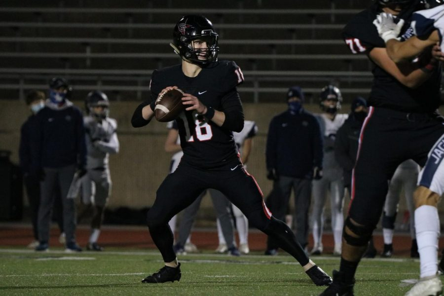 Coppell senior quarterback Ryan Walker looks for an open receiver against Flower Mound on Friday at Buddy Echols Field. With a 51-28 win over the Jaguars, the Cowboys face Denton Guyer on Saturday at 1 p.m. at C.H. Collins Complex in Denton in the Class 6A Region I bi-district playoffs.