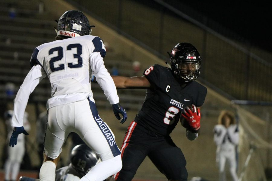 Coppell senior running back Jason Ngwu looks for an opening in the backfield against Flower Mound on Dec. 4 at Buddy Echols Field. The Cowboys face Denton Guyer on Saturday at 1 p.m. at C.H. Collins Complex in Denton in the Class 6A Region I bi-district playoffs.