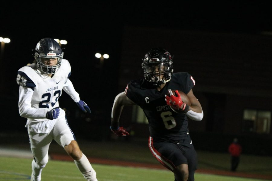 Coppell senior running back Jason Ngwu rushes against Flower Mound on Friday at Buddy Echols Field. With a 51-28 win over the Jaguars, the Cowboys face Denton Guyer on Saturday at 1 p.m. at C.H. Collins Complex in Denton in the Class 6A Region I bi-district playoffs.