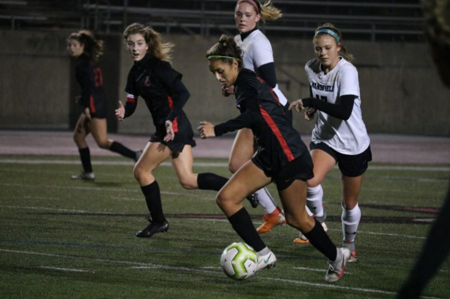 Coppell senior forward Jojo Alonzo drives against Mansfield at Buddy Echols Field last night. Coppell and Mansfield tied, 1-1, in the Cowgirls' first scrimmage of the season.