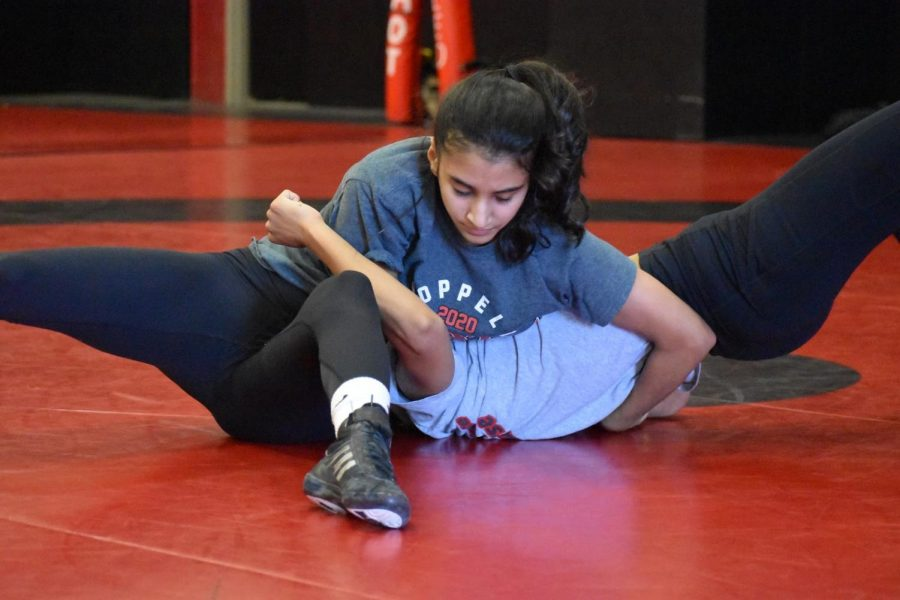 Coppell junior Maria Husain takes a break during practice at the CHS field house on Dec. 7. In addition to being a key wrestler on the Coppell team, Husain is social outreach manager of Amnesty International.