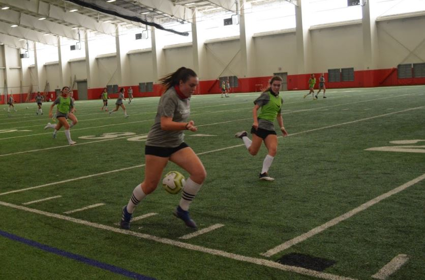 Coppell senior midfielder Maya Ozymy dribbles during practice in the Coppell High School Field House on Dec. 4. The Cowgirls play Mansfield in their first scrimmage of the season tomorrow at 7:30 p.m.