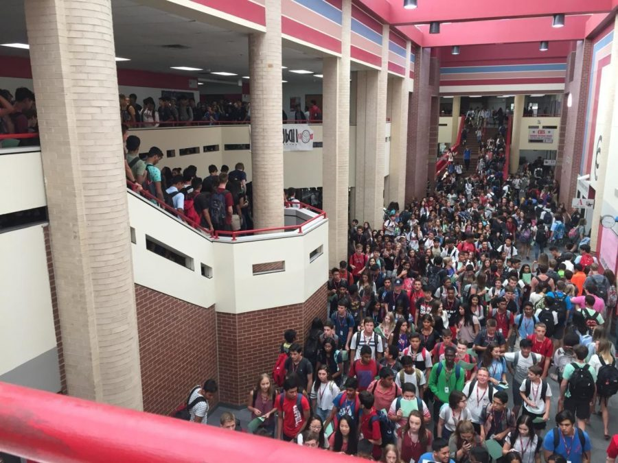 Coppell High School students navigate the main hall during passing period in the 2017-18 school year. One year after the last regular day of school at CHS, the community is still upholding various coronavirus-related guidelines, such as social distancing and wearing masks.