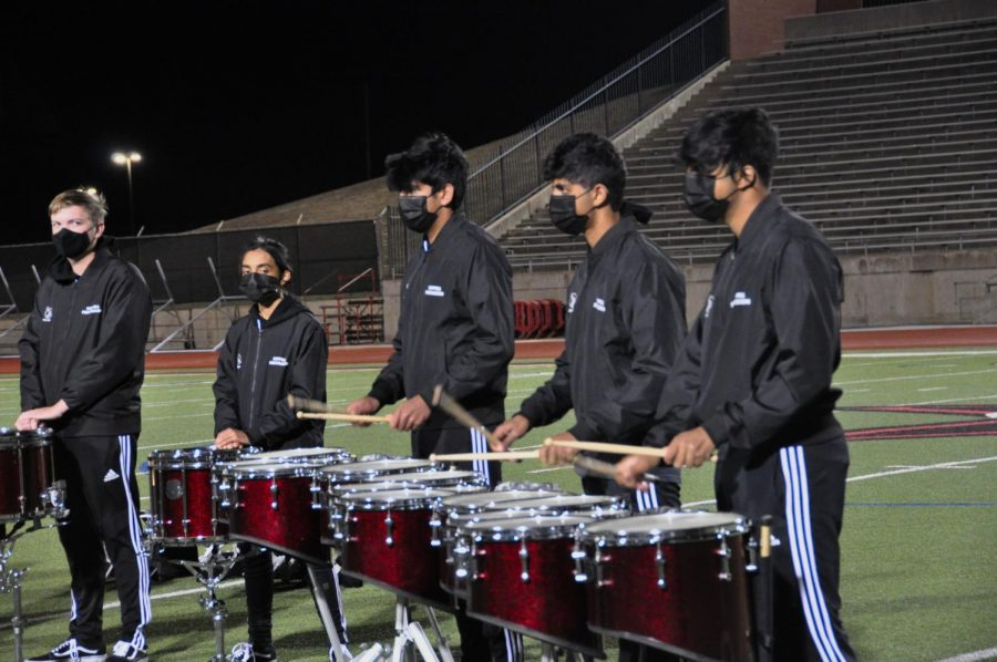 Coppell High School junior quad drummer section leader Ashrith Anumala, junior quad drummer Pranav Govil and sophomore quad drummer Aman Singhal perform their feature from the Coppell Varsity Drumline Show Attrå on Tuesday night at Buddy Echols Field. Today, the Drumline will finish their season.
