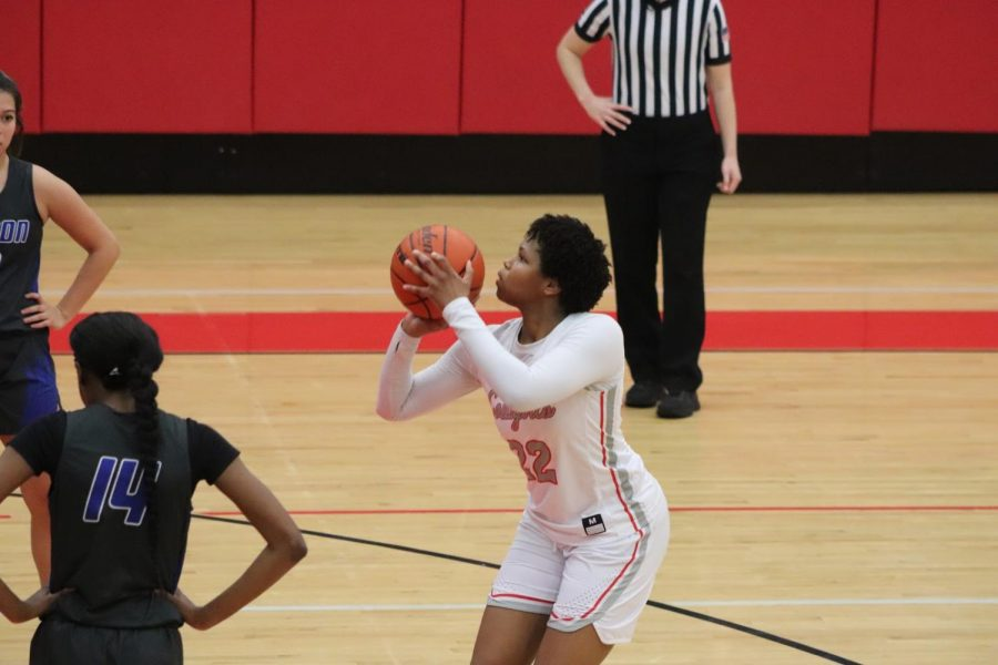 Coppell junior center India Howard shoots a free throw against Hebron on Tuesday in the CHS Arena. The Cowgirls defeated the Hawks, 50-49. Photo courtesy Joyce Ahn/Round-Up.