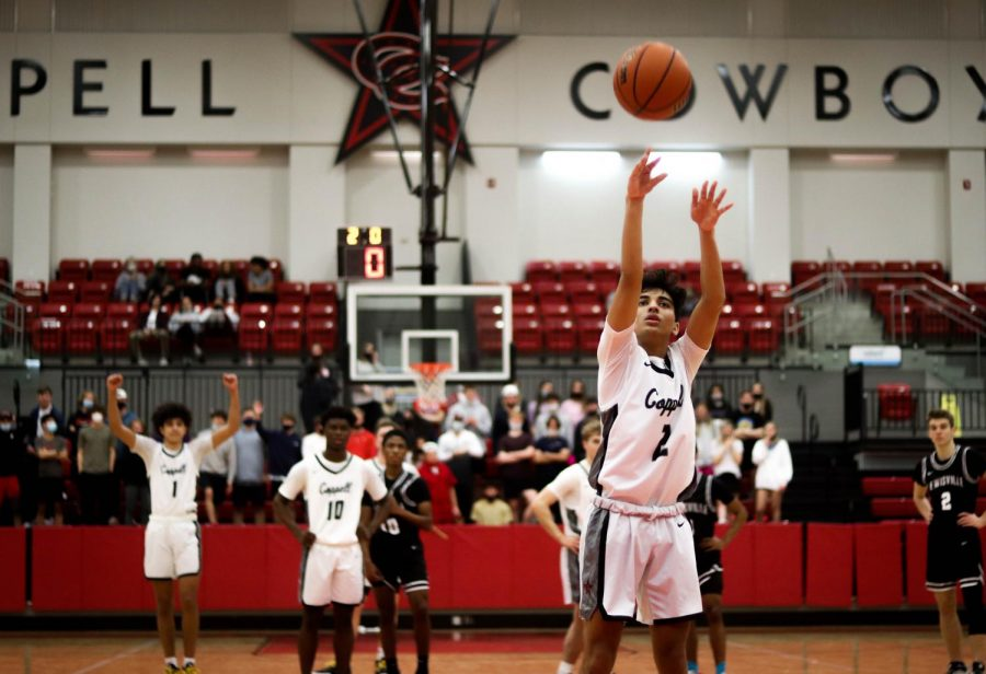 Coppell junior shooting guard Devank Rane shoots a free throw during overtime to end the game versus Lewisville on Friday night in the CHS Arena. The Cowboys defeated the Farmers in overtime, 70-65, to keep possession of their first place seat in District 6-6A.