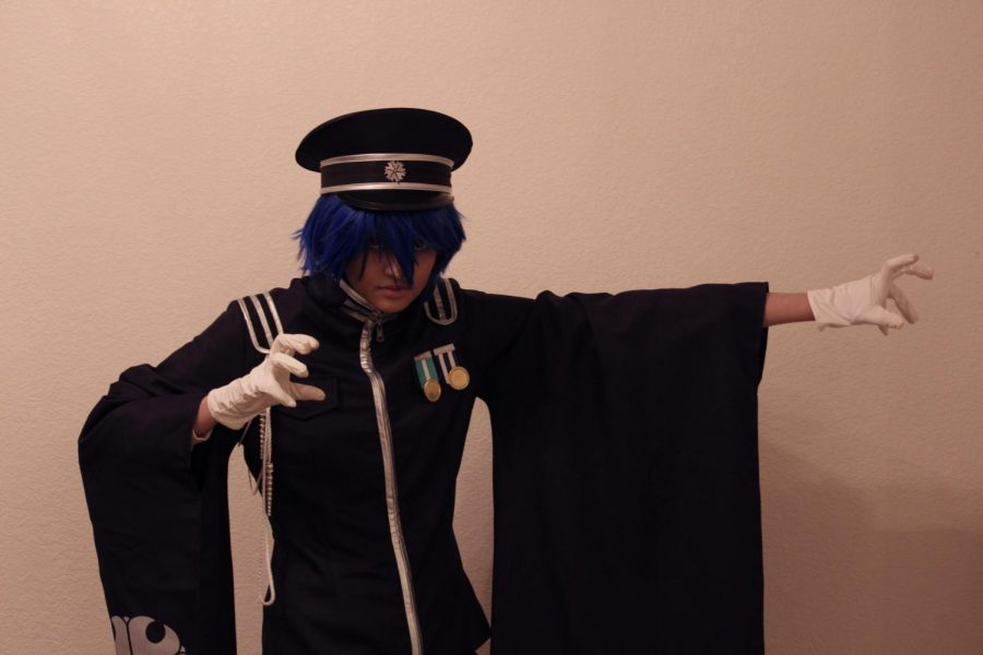 Coppell High School senior Sneha Kumar dresses as Kaito from Vocaloid in her home on Wednesday. Kumar started cosplaying in the seventh grade and has been many characters since. Photo by Olivia Cooper
