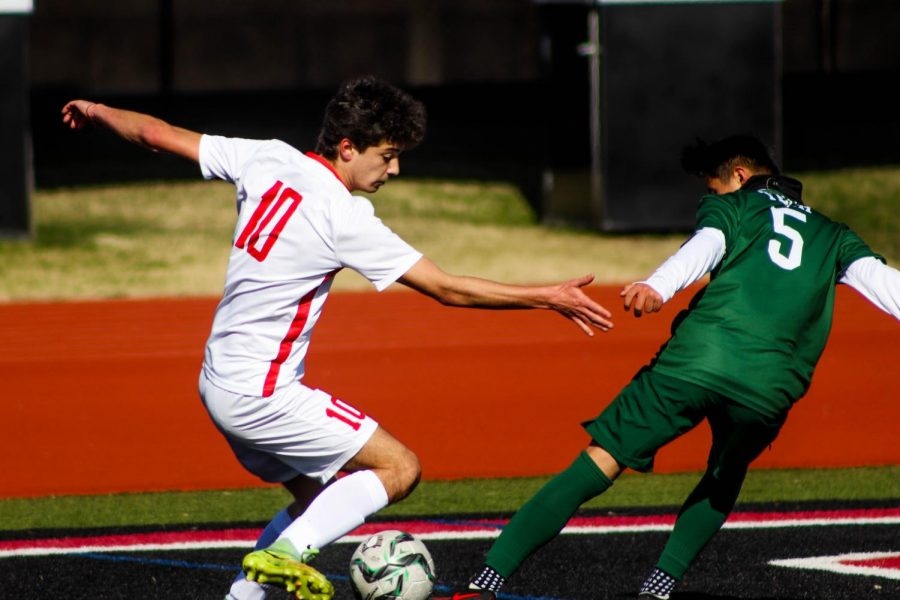 Coppell sophomore midfielder Alejandro Reyes dribbles against Trimble Tech at Buddy Echols Field on Friday. The Cowboys defeated the Bulldogs, 6-0, in the North Texas Elite Showcase.
