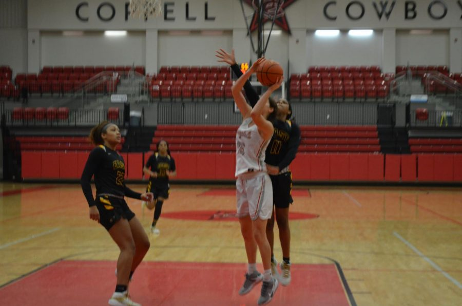 Coppell senior forward Chloe Hassman shoots against Plano East at the CHS on Friday. Coppell lost, 35-33, to Plano East in its first home game of 2021.