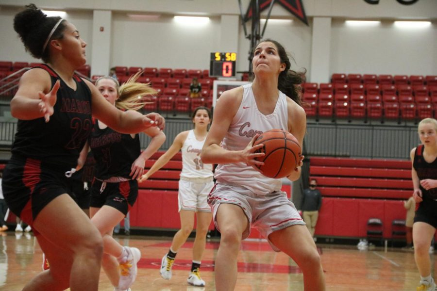 Coppell senior forward Chloe Hassman attempts to go up for a shoot against Marcus on Friday in the CHS Arena. The Cowgirls defeated Marauders, 51-40.