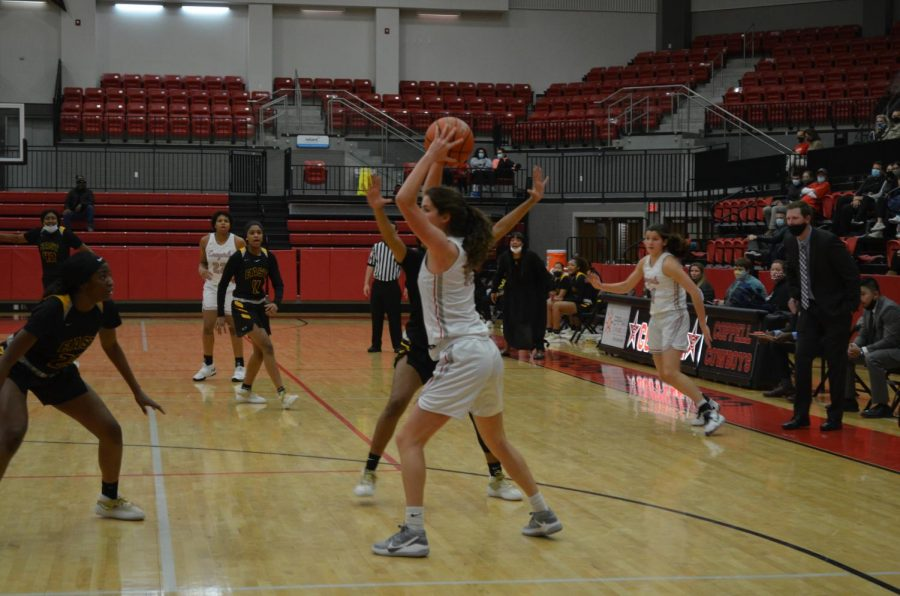 Coppell senior forward Chloe Hassman passes against Plano East at the CHS Arena on Friday. Coppell lost, 35-33, to Plano East in its first home game of 2021.