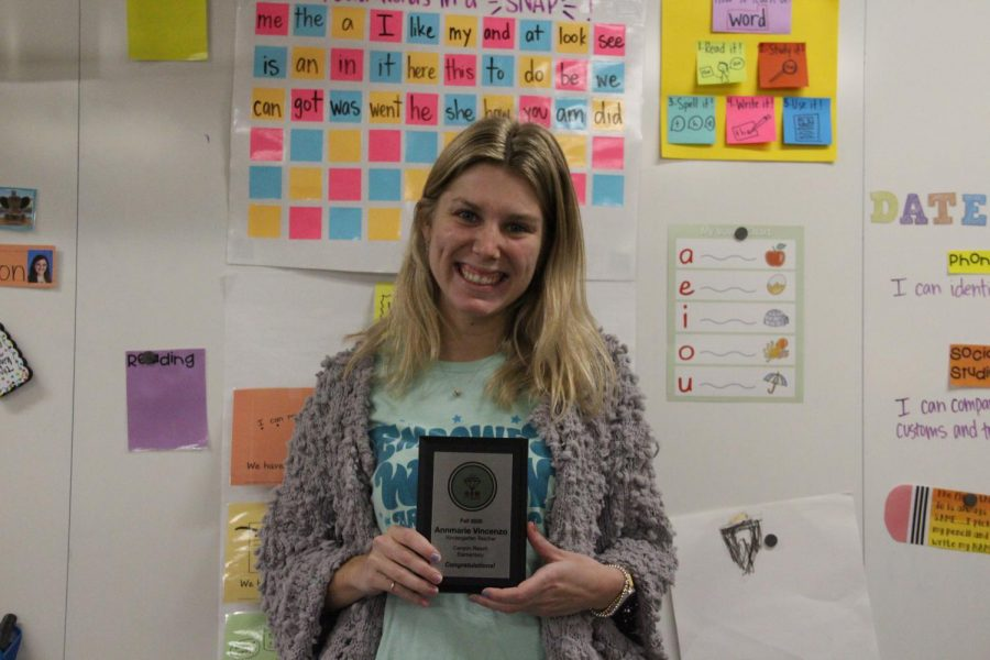 Coppell kindergarten teacher Annmarie Vincenzo holds her Great Employees Matter plaque in Canyon Ranch.Elementary on Wednesday. Vincenzo was nominated for this award by her colleagues for going above and beyond with her teaching.