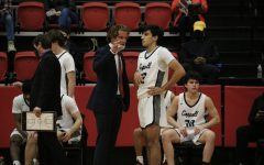 Coppell assistant Landon Goesling talks to Coppell sophomore guard Alex Ninan on Friday in the CHS Arena. After graduating from CHS in 2014 and serving as a graduate assistant at University of Houston, Goesling returned as an assistant coach this year.