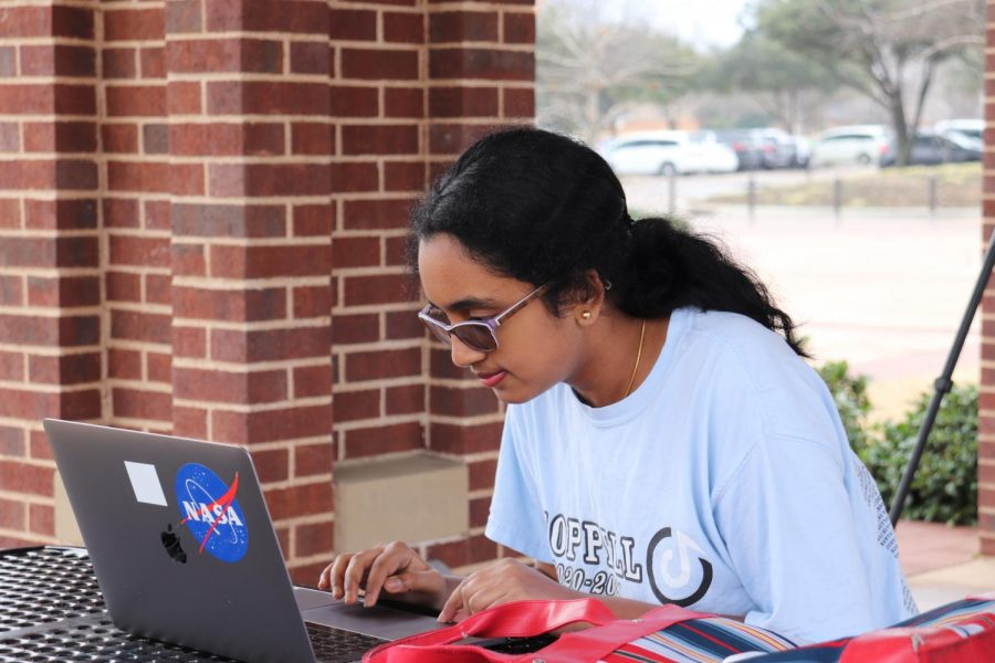 Coppell High School senior Swetha Tandri creates a new song at Andy Brown Park East on Saturday. Tandri has been using music as a tool to teach math to kids.