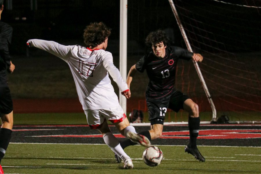 Coppell senior defender Daniel Nelson blocks McKinney Boyd George Colandrea during the game on Tuesday night at Buddy Echols Field. The Cowboys defeated the Broncos, 2-1.