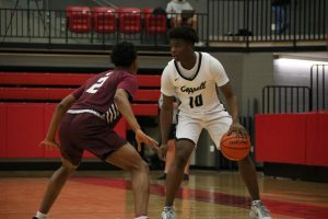Coppell junior guard Naz Brown looks for an open teammate against Plano junior guard Makhi Dorsey on Friday in the CHS Arena. Brown joins 3d Hoops Academy teammates junior guards Anthony Black and Ryan Agarwal at Coppell after transferring from Hurst L.D. Bell.