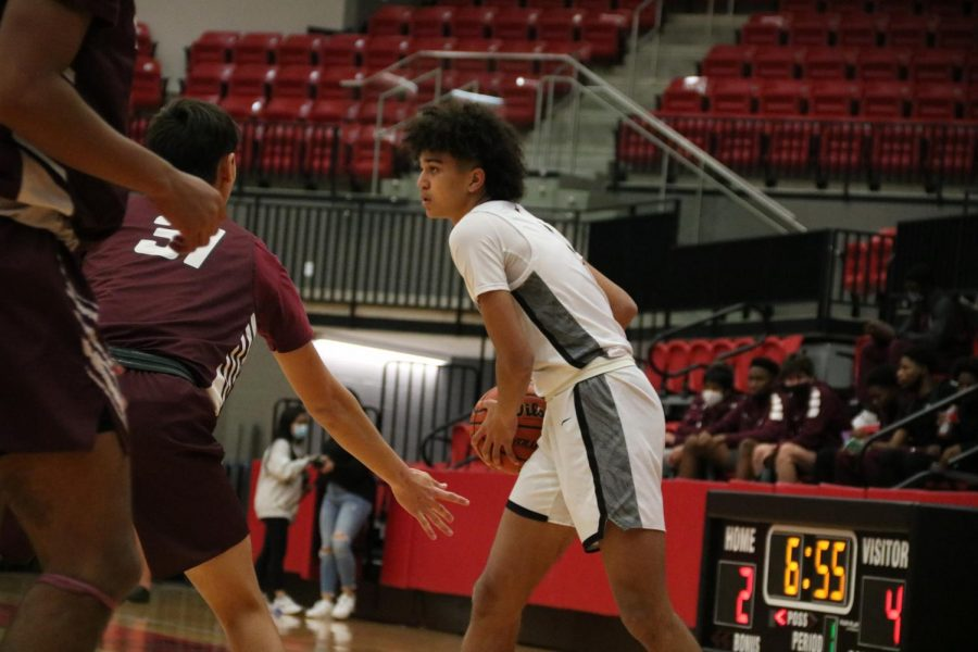 Coppell junior guard Anthony Black passes against Plano in the CHS Arena on Jan. 15. The Cowboys will take on Hawks at 8 p.m. tomorrow night in District 6-6A play.