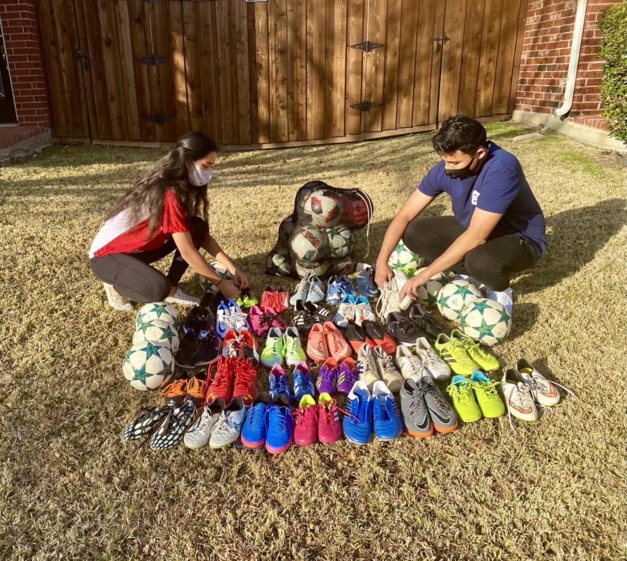 Coppell High School senior Binivaa Manandhar and 2017 CHS l graduate and co-founder Bishesh Manandhar organize cleats and soccer balls outside of their home on Saturday. Soccer For Nepal was established in 2016 after the Manandhar siblings realized the dangers the lack of cleats can cause as children play barefoot in Nepal.