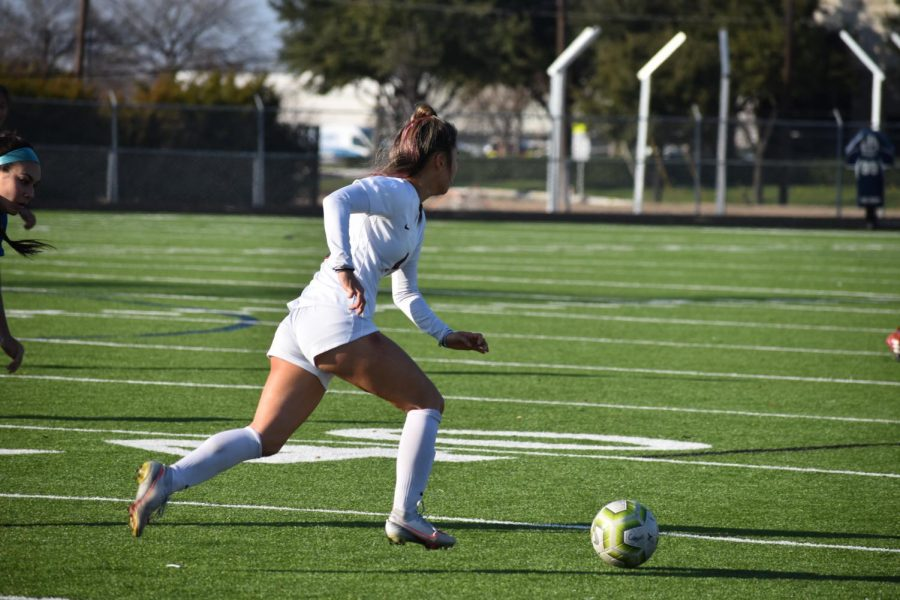 Coppell junior forward Michelle Pak runs downfield against Frisco Frenship on Jan. 8 at Lesley Field. The Coppell girls soccer season is on hold until Feb. 5 due to a positive COVID-19 case.