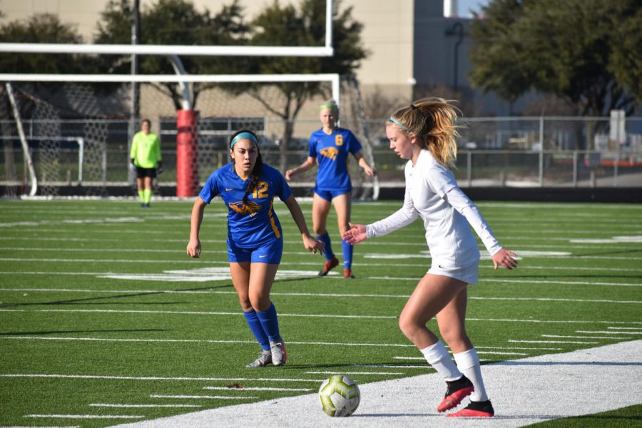Coppell freshman defender Elle Dinsmore passes against Frisco Frenship at Lesley Field on Jan. 8. The Cowgirls face Plano tomorrow at 7:30 p.m. at Buddy Echols Field in their District 6-6A opener.