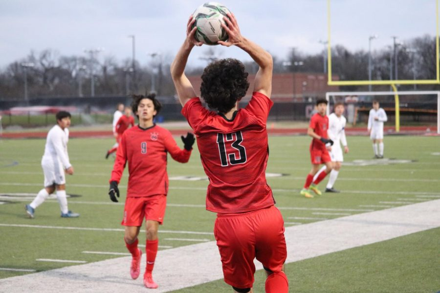 Coppell senior defender Daniel Nelson throws in against Denton Guyer at Buddy Echols Field on Jan. 7. The Cowboys led Denton Guyer until allowing two goals in the second half, finishing with a 2-1 loss.