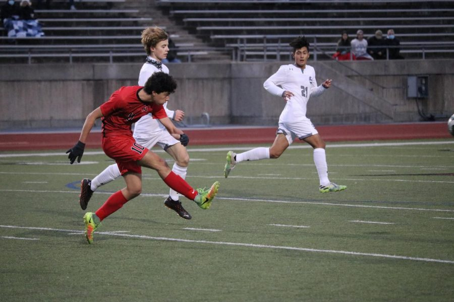 Coppell senior midfielder Garrett Greaves passes against McKinney Boyd senior defender Braydon Widra on Jan. 19 at Buddy Echols Field. Coppell plays Plano West in its first home match of district play tonight at 7:30 p.m. at Buddy Echols Field.