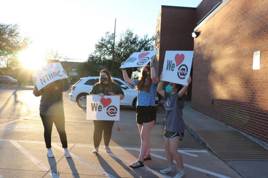 New Tech High @ Coppell seniors Sydney Kutz, Emily Reynolds, Megan Chambless and Autumn Kranz protest against closing the school on Monday night during the Coppell ISD Board of Trustees meeting. The Board of Trustees declared closing NTH@Coppell and cutting the International Baccalaureate program at Coppell High School would be their last resort choices to offset the deficit.