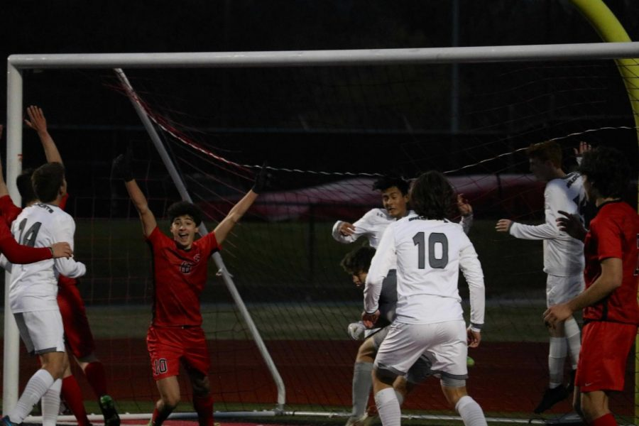 Coppell sophomore forward Alejandro Reyes celebrates among his teammates after the Cowboys score their only goal of the night against Denton Guyer on Thursday at Buddy Echols Field. Denton Guyer defeated the Cowboys 2-1.
