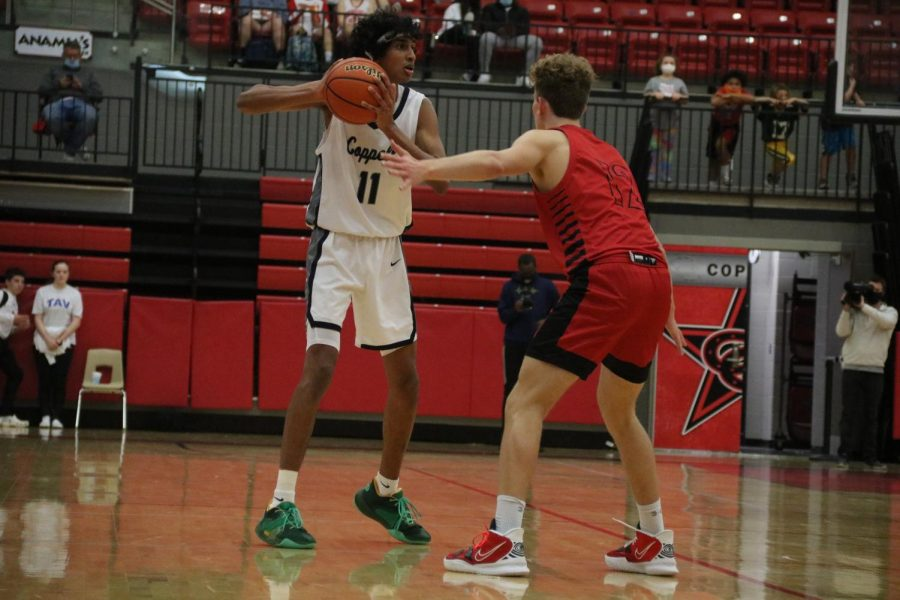 Coppell junior shooting guard Ryan Agarwal shoots against Hebron senior David Deal on Tuesday at the CHS Arena. The Cowboys defeated Hebron, 66-56.
