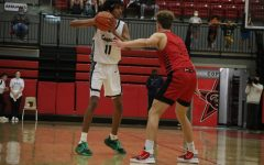 Coppell junior shooting guard Ryan Agarwal looks for an open teammate against Marcus senior guard Brock Susko on Friday in the CHS Arena. The Cowboys defeated the Marauders, 58-54, to take over first place in District 6-6A.