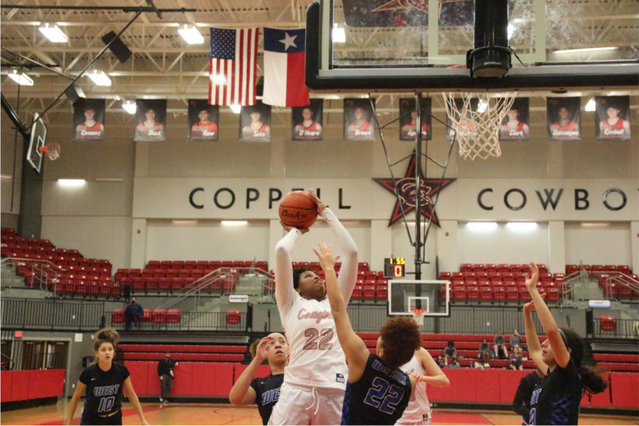 Coppell junior power forward India Howard shoots a jump shot against Plano West sophomore forward Khamryn Hopkins. Coppell defeated Plano West in overtime, 66-65.