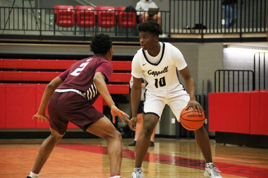 Coppell+junior+point+guard+Nazir+Brown+looks+for+an+open+teammate+against+Plano+junior+guard+Makhi+Dorsey+on+Friday+in+the+CHS+Arena.+The+Cowboys+held+the+lead+in+all+four+quarters%2C+ending+with+a+59-54+win+over+the+Wildcats.