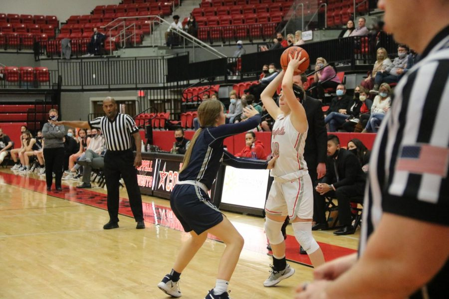 Coppell senior guard Emma Sherrer passes against Flower Mound at the CHS Arena on Friday. The Cowgirls won their final game of the season, 55-48, finishing fifth in District 6-6A. Photo by Olivia Cooper