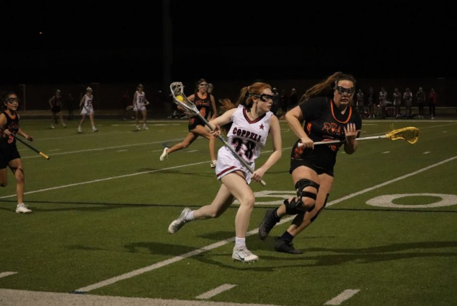 Coppell junior attacker Anna Terry cradles against Rockwall at the Coppell Middle School North field on Wednesday. Coppell lost, 15-9.