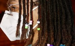 Coppell High School senior M.J. Green displays the locs and beads hairstyle in the Black Box Theater at CHS on Wednesday. Green is a student in theater and the historian for the Drama Club and hopes to be an archivist.
