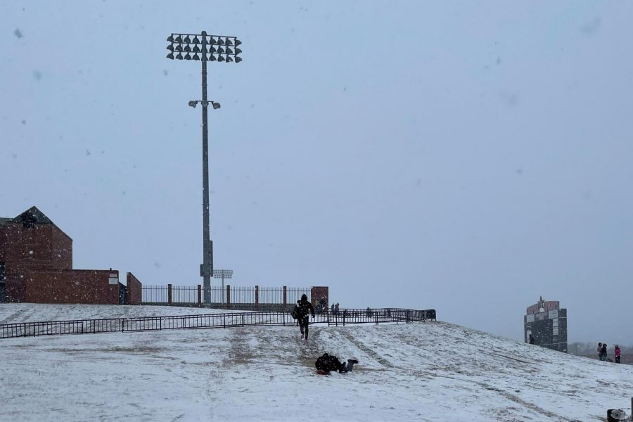 Coppell High School students play in the freshly fallen snow near Buddy Echols Field yesterday. This afternoon, Coppell ISD announced via email that all campuses will be closed through Friday due to inclement weather.