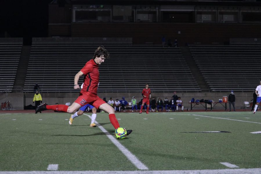 Coppell senior defender Collin Macdonald plays a long ball against Plano West on Jan. 29 at Buddy Echols Field. The Cowboys host Marcus in a  rivalry match tomorrow night at Buddy Echols field, with kickoff at 7:30 p.m.