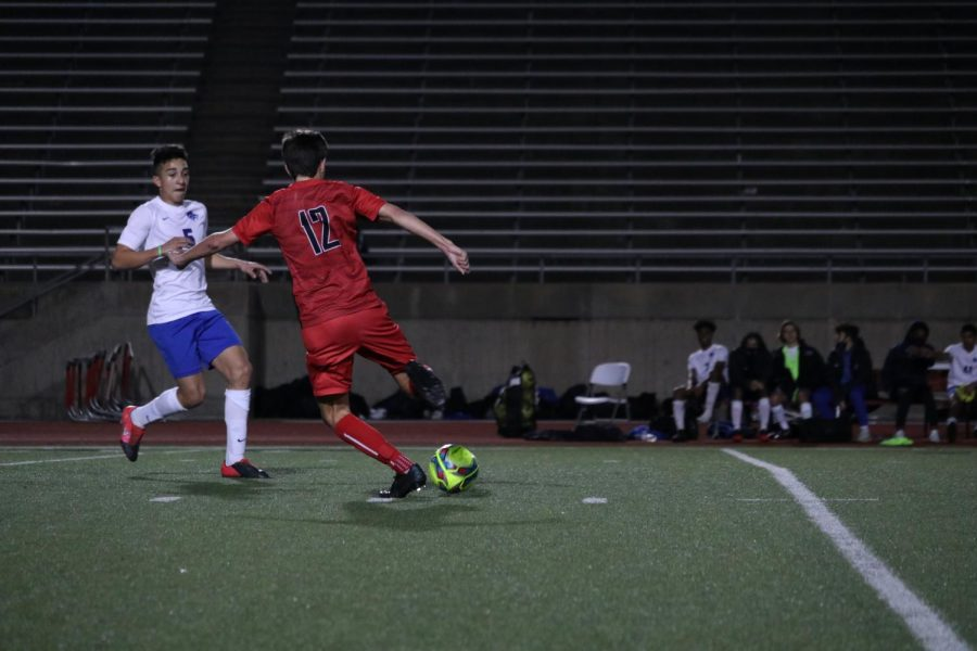 Coppell junior midfielder Walker Stone kicks against Plano West Wolves during the game on Jan. 29 at Buddy Echols Field. The Cowboys defeated the Wolves, 2-0.
