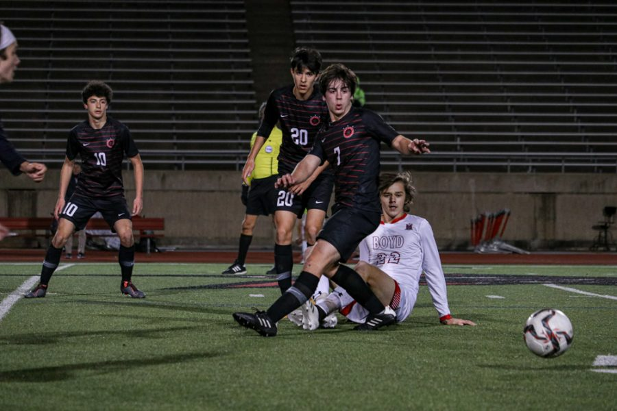 Coppell senior defensive mid Garret Greaves passes against Lewisville on Feb. 9 at Buddy Echols Field. Coppell soccer was paused due to inclement weather this week but returns to play next week.