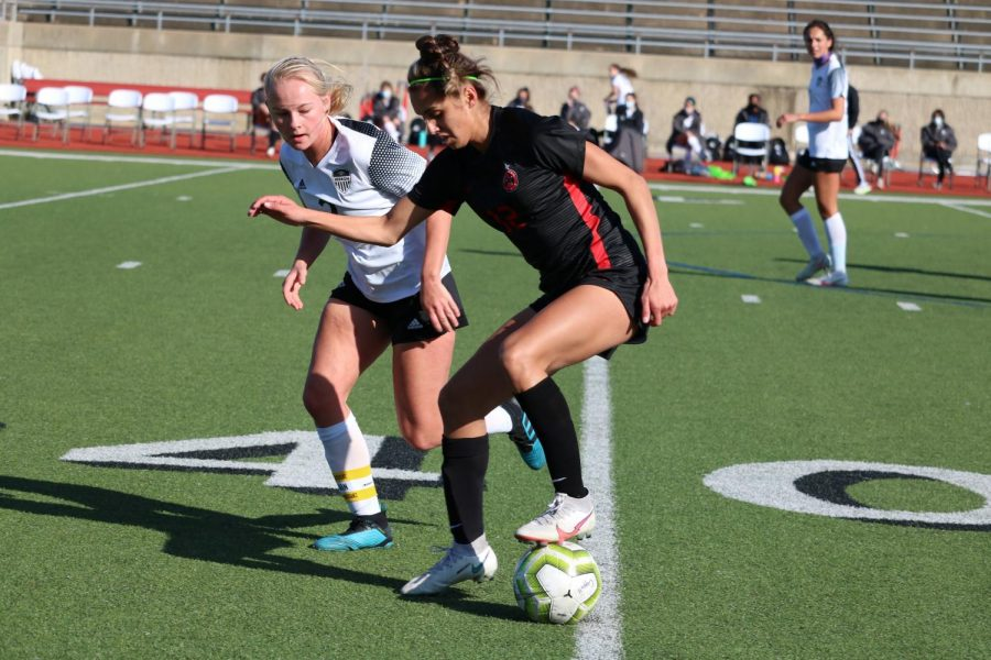 Coppell senior forward Jojo Alonzo shields against Hebron on Saturday at the Buddy Echols Field. The Cowgirls tied the Hawks, 1-1.