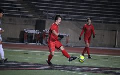 Coppell senior defensive midfielder Garret Greaves passes against Lewisville on Feb. 9 at Buddy Echols Field. The Cowboys host Plano tonight and Marcus tomorrow, kickoff at 7:30 p.m.