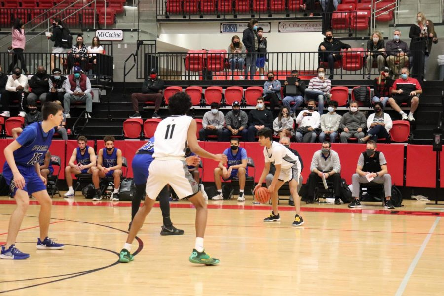 Coppell junior shooting guard Devank Rane dribbles while Coppell junior shooting guard Ryan Agarwal, Hebron senior David Deal and Hebron senior Grayson Allo anticipate his next move in the CHS Arena on Tuesday. Coppell hosts Plano East on Tuesday night at 8 p.m. in the CHS arena.