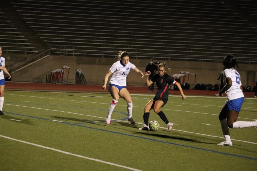 Coppell senior forward Jocelyn Alonzo kicks against Plano West senior midfielder Karsen Aguirre at Buddy Echols Field on Tuesday. Coppell defeated Plano West, 1-0.
