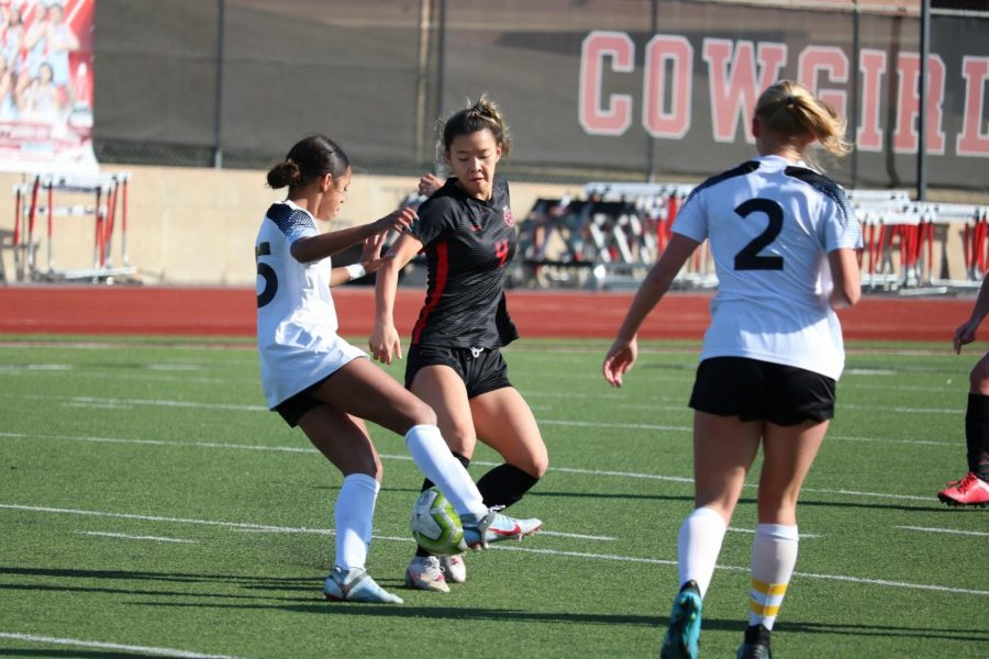 Coppell junior midfielder Michelle Pak dribbles against Hebron on Feb. 6 at the Buddy Echols Field. The Cowgirls host Plano West tomorrow at 7:30 p.m.