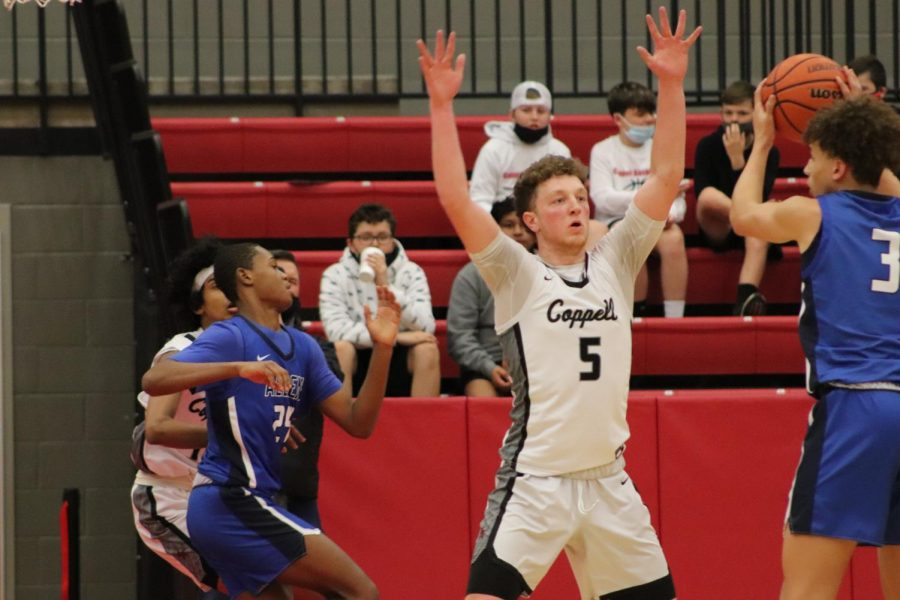Coppell senior center Tim O'Hearn defends against Allen junior forward Miles Gibson on Saturday in the CHS Arena. The Cowboys play Lake Highlands in the Class 6A area playoffs tomorrow at Loos Sports Complex in Addison, with tipoff at 7 p.m.