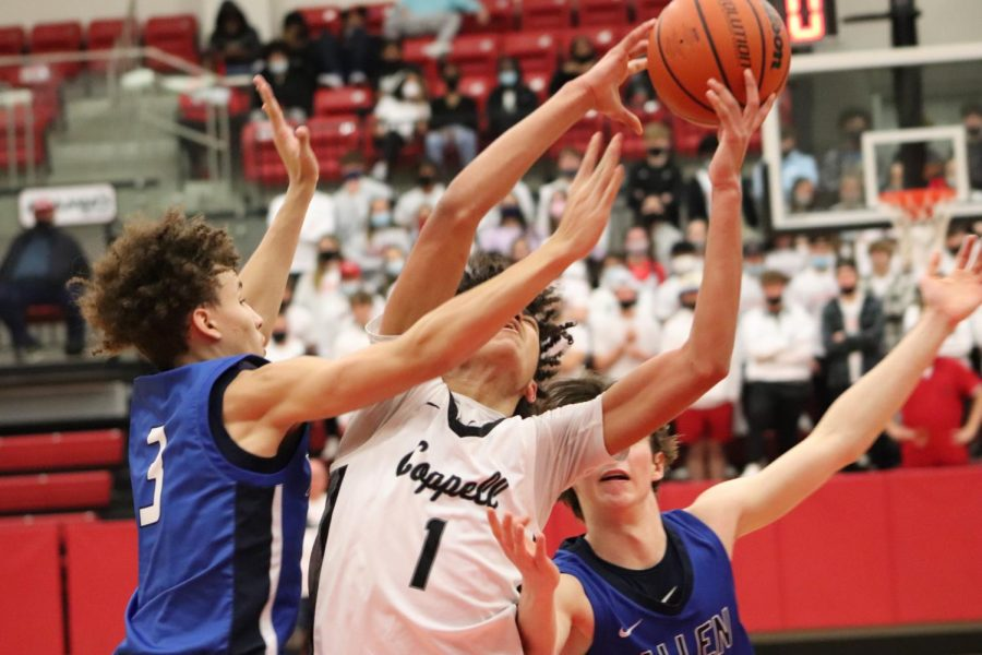 Coppell junior guard Anthony Black is defended by Allen junior power forward Miles Gibson and senior guard Blaine Green, fouled by Gibson at the CHS Arena on Saturday. The Cowboys defeated the Eagles, 64-46, in the Class 6A bi-district playoffs.
