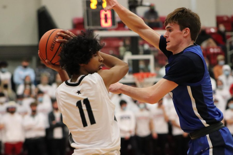 Coppell junior guard Ryan Agarwal avoids defensive pressure from Allen senior forward Ian Motta at the CHS Arena on Feb. 20. Agarwal announced his commitment to Stanford University, his dream school, on March 16.
