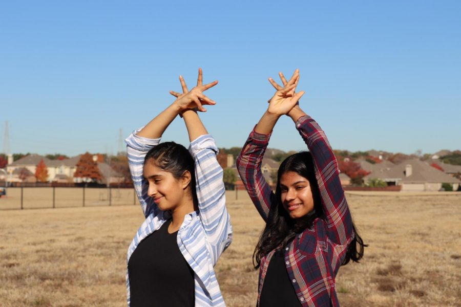 Coppell High School sophomores Aarushi Anand and Medha Jain dance at the Canyon Ranch Elementary field to practice on Dec. 10. Anand and Jain's love for Bollywood and hip-hop fusion dance sparked them to create the Spirit of Dance club.