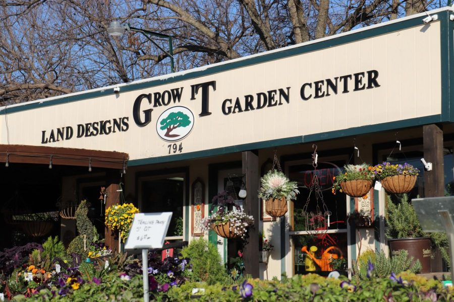The entrance of Grow it Land Designs and Garden Center surrounds itself with hanging plants and succulents on Wednesday. Grow It maintains a garden shop with a large botanical space at the backside of the store and offers help with land design.